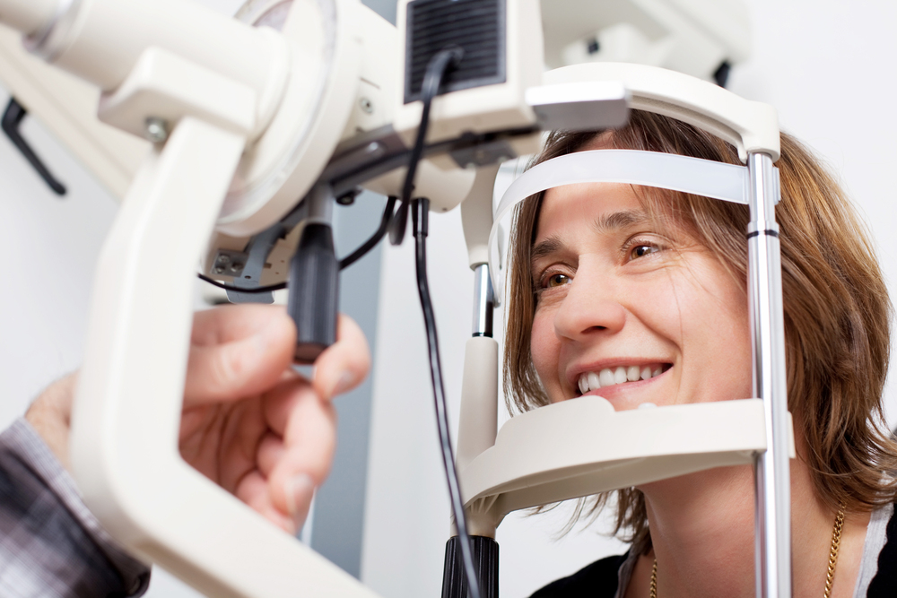 Woman getting her eyes checked by an Ophthalmologist.